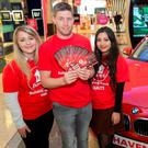 Amy Regan (Infinity Fundraising), Ronan O'Gara and Ovia Cisang (Infinity Fundraising) in Dundrum Shopping Centre, Dublin, where Haiti charity Haven is is running a competition to give away a BMW 116d