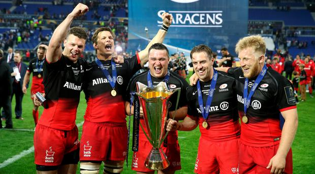 (Left to right) Saracens' Duncan Taylor, Michael Rhodes, Jamie George, Chris Wyles and Jackson Wray celebrate winning the European Champions Cup. Photo: Adam Davy/PA Wire