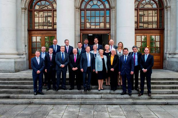Enda Kenny with the full line-up of 15 new and three already appointed junior ministers. Photo: Doug.ie