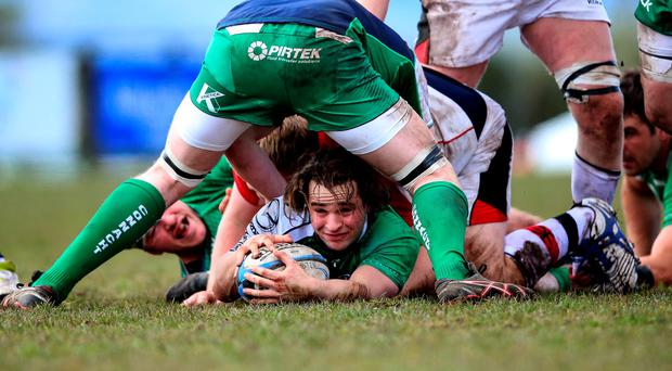 Scrum-half Dylan Carpenter in a ruck. Photo: Tommy Dickson/INPHO