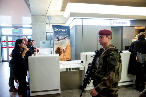 A soldier passes the EgyptAir flight check-in desk at Charles de Gaulle airport in Roissy, France, yesterday. Photo: Bloomberg
