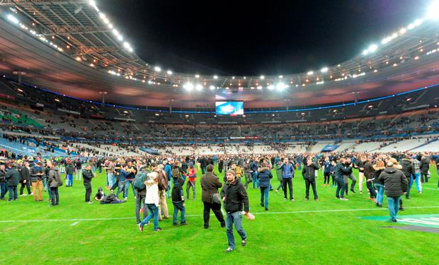 People on the pitch at the Stade de France after a suicide bombing. Photo: Getty