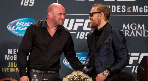 UFC President Dana White (L) and UFC featherweight champion Conor McGregor