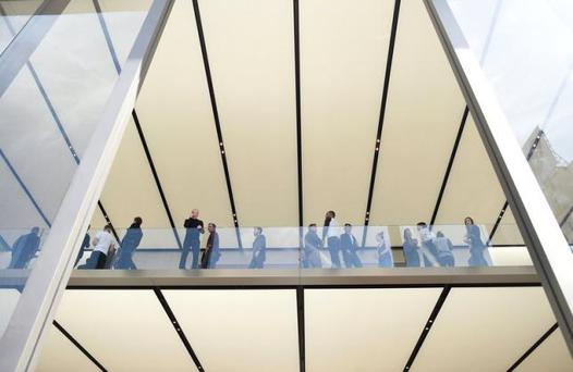 Apple workers wait for the start of a media preview event at Apple's new retail location in San Francisco, California, U.S., May 19, 2016. REUTERS/Noah Berger