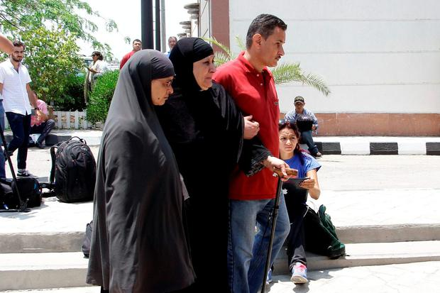 Relatives of passengers on an EgyptAir flight that crashed early Thursday walk past journalists at Cairo International Airport, Egypt, Thursday, May 19, 2016