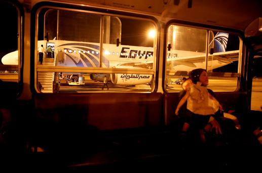 A passenger and her daughter sit in a bus after their EgyptAir flight arrived from Cairo to Luxor International Airport, Egypt May 19, 2016