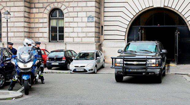 Police secure the street as a vehicle believed to transport Paris attacks suspect Salah Abdeslam departs the courthouse after his first hearing before French judges in Paris, France, May 20, 2016