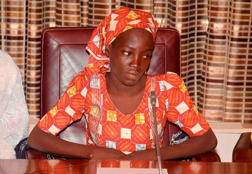 Amina Ali, the rescue Chibok school girl, sits during a meeting with Nigeria's President Muhammadu Buhari at the Presidential palace in Abuja, Nigeria, Thursday, May. 19, 2016