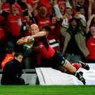 Peter Stringer, above, dives over to score a try against Biarritz in the 2006 Heineken Cup Final. SPORTSFILE