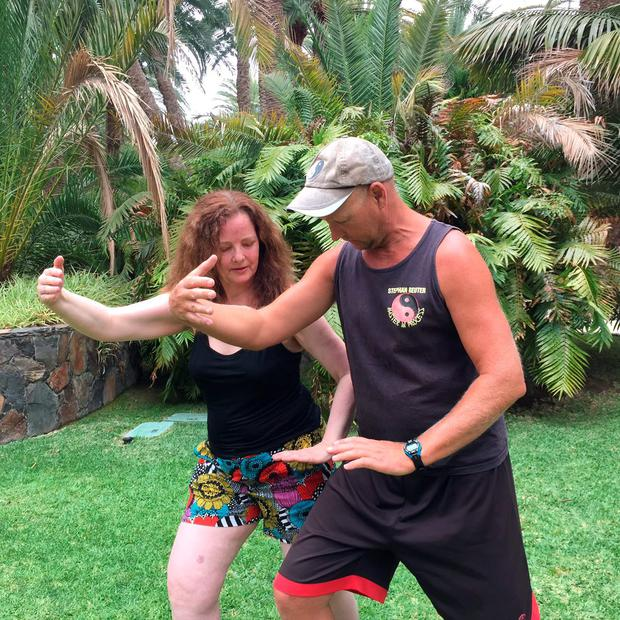 Constance receives lessons in Tai Chi from Stephan Reuter.