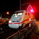In this May 20, 2016 picture provided by police in Bern, Switzerland a damaged train waits after it crashed into an Austrian bus at a railroad-crossing near Interlaken, Switzerland