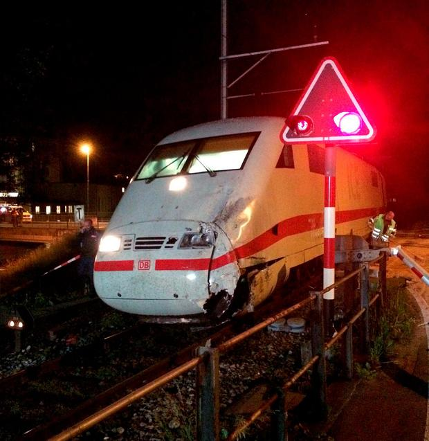 At least 16 injured after high speed train crashes into bus