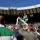 LASGOW, SCOTLAND - MAY 21: Hibernian fans invade the Hampden Park Pitch at the final whistle as Hibernian beat Rangers 3-2 during the William Hill Scottish Cup Final between Rangers FC and Hibernian FC at Hamden Park on May 21, 2016 in Glasgow, Scotland. (Photo by Mark Runnacles/Getty Images)
