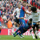 Manchester United's Belgian midfielder Marouane Fellaini (R) wins a header from Crystal Palace's Australian midfielder Mile Jedinak during the English FA Cup final football match between Crystal Palace and Manchester United at Wembley stadium in London on May 21, 2016. / AFP / Adrian DENNIS / NOT FOR MARKETING OR ADVERTISING USE / RESTRICTED TO EDITORIAL USE (Photo credit should read ADRIAN DENNIS/AFP/Getty Images)