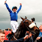ockey Chris Hayes celebrates aboard Awtaad after winning the Tattersalls Irish 2,000 Guineas at the Curragh. Photo: Paul Mohan/Sportsfile