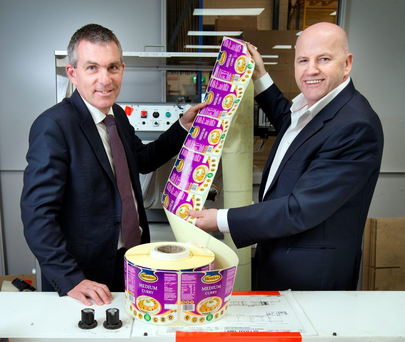 James Costello, managing director of Label Tech, is pictured with Sean Gallagher at the company's base in Santry Photo: INM