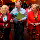 Game on: Taoiseach Enda Kenny with Tanaiste, Frances Fitgerald, talks to journalists after the Fine Gael Party meeting in Athlone Photo: Damien Eagers