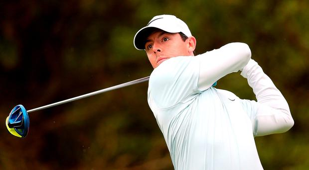 Rory McIlroy of Northern Ireland tees off on the 11th hole. Photo: Getty