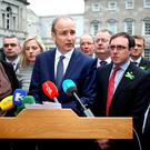 MORTGAGES: Micheal Martin with his front bench colleagues outside Leinster house. The FF Bill empowering the Central Bank to cap certain mortgage lending rates will please mortgage borrowers but will hardly appeal to the Central Bank, which has not sought these powers. Photo: Gerry Mooneyin