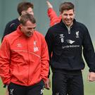 LIVERPOOL, ENGLAND - MAY 14: (THE SUN OUT, THE SUN ON SUNDAY OUT) Steven Gerrard talks with Brendan Rodgers manager of Liverpool during a training session at Melwood Training Ground on May 14, 2015 in Liverpool, England. (Photo by Andrew Powell/Liverpool FC via Getty Images)