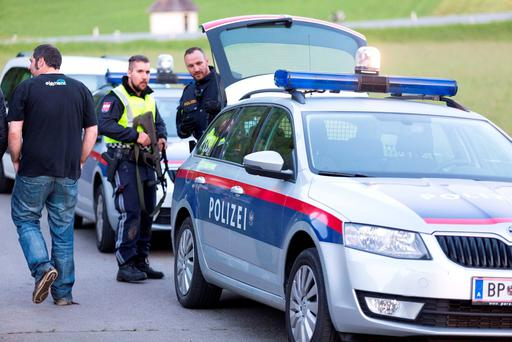 Police stand guard on May 22, 2016 in Nenzing, near Vorarlberg, at the scene of a shooting where a man fatally shot two individuals and wounded eleven during a village party, before killing himself
