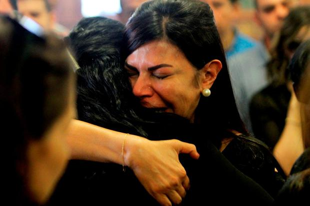 Relatives and friends of EgyptAir hostess Yara Hani, who was onboard Flight MS804 from Paris to Cairo shortly before it plunged into the Mediterranean, mourn during a ceremony at a church in Cairo on May 21, 2016