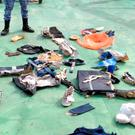An image grab taken from a video uploaded on the official Facebook page of the Egyptian military spokesperson on May 21, 2016 and taken from an undisclosed location reportedly shows some debris that the search teams found in the sea after the EgyptAir Airbus A320 crashed in the Mediterranean.