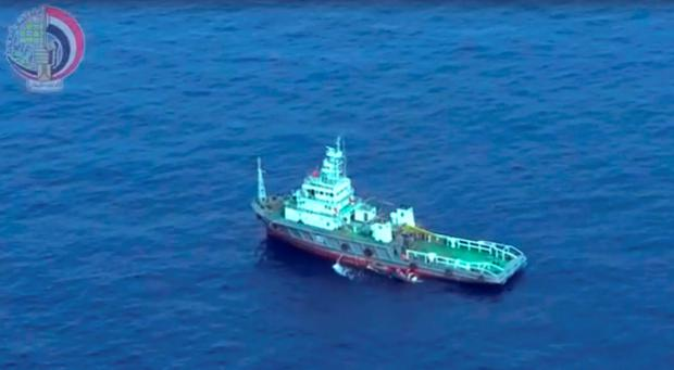 This still image taken from video posted Saturday, May 21, 2016, on the official Facebook page of the Egyptian Armed Forces spokesman shows an Egyptian ship collecting wreckage of EgyptAir flight 804