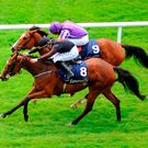 Jet Setting ridden by Shane Foley (front) goes on to win the Tattersalls Irish 1,000 Guineas ahead of Minding ridden by Ryan Moore during day two of the Tattersalls Irish Guineas Festival at the Curragh