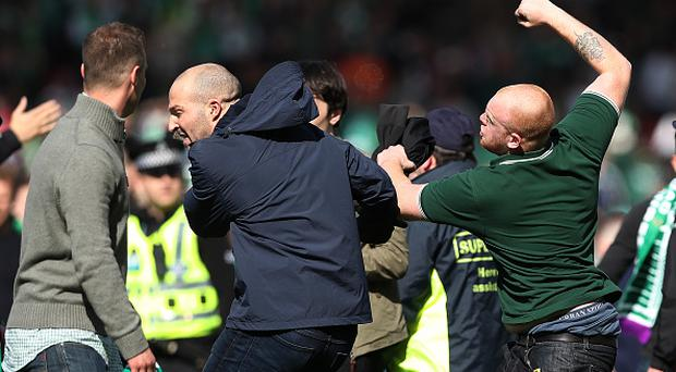 GLASGOW, SCOTLAND - MAY 21: Fans fight on the pitch during the Scottish Cup Final between Rangers and Hibernian at Hampden Park on May 21, 2016 in Glasgow, Scotland. (Photo by Ian MacNicol/Getty)