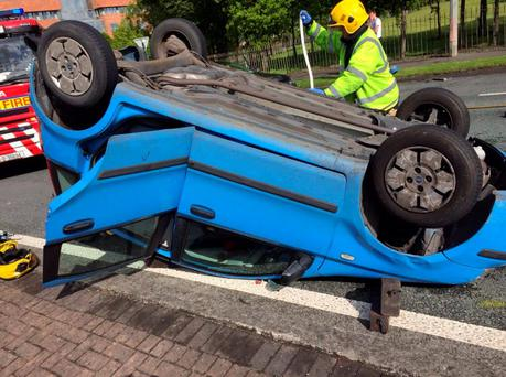 Car rollover in Tallaght. Photo: @DubFireBrigade