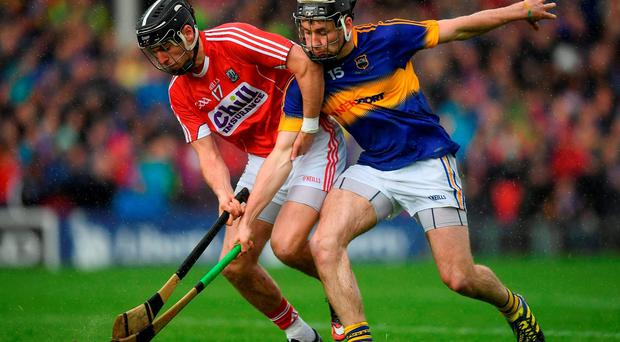 22 May 2016; Killian Burke of Cork in action against John McGrath of Tipperary during the Munster GAA Hurling Senior Championship Quarter-Final match between Tipperary and Cork at Semple Stadium in Thurles, Co. Tipperary. Photo by Stephen McCarthy/Sportsfile