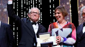 """Director Ken Loach (L), Palme d'Or award winner for his film """"I, Daniel Blake"""", reacts next to producer Rebecca O'Brien during the closing ceremony of the 69th Cannes Film Festival in Cannes, France. Photo: Reuters/Yves Herman"""