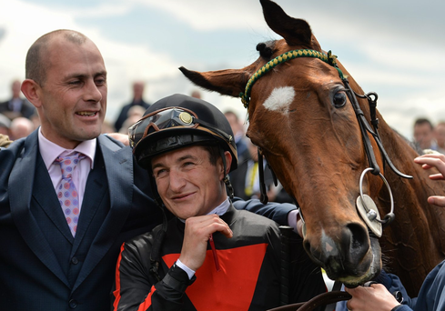 Trainer Adrian Keatley, left, and jockey Shane Foley celebrate with Jet Setting after winning the Tattersalls Irish 1,000 Guineas race at the Curragh. Photo: Brendan Moran/Sportsfile