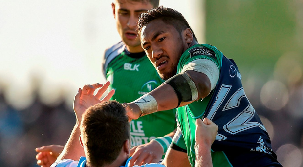 Connacht's Bundee Aki tussles with Mark Bennett of Glasgow Warriors during the Guinness PRO12 Play-off match at the Sportsground in Galway. Photo: Ramsey Cardy/Sportsfile