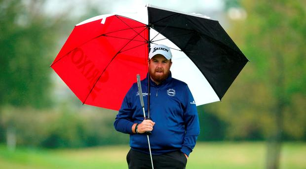 Ireland's Shane Lowry shelters under an umbrella during the Irish Open at The K Club. Photo: Brian Lawless/PA