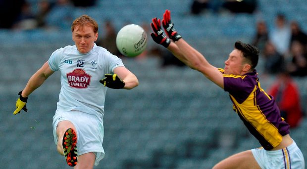 Paul Cribbin of Kildare is closed down by Wexford's Eoghan Nolan during Saturday's Leinster SFC clash in Croke Park. Photo: Sportsfile