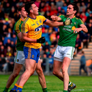 John McManus of Roscommon and Leitrim's Darren Sweeney get involved in a tussle led to Sweeney being shown a red card. Photo: Sportsfile