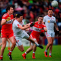 Sean Cavanagh of Tyrone in action against James Kielt, centre, of Derry. Photo: Sportsfile