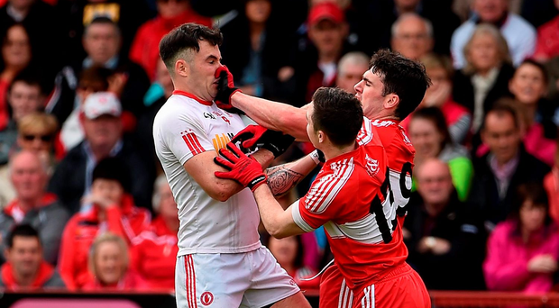 Tyrone defender Cathal McCarron tries to fend off the attentions of Derry pair Niall Toner and Danny Heavron in Celtic Park. Photo: Sportsfile