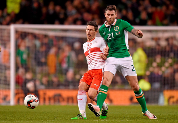 The Republic of Ireland's Daryl Murphy in action against Switzerland's Fabian Schär at the Aviva Stadium in March. Photo: Sportsfile