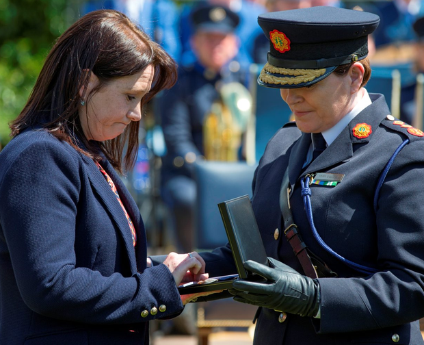 Nicola Golden, widow of Garda Tony Golden, is presented with a remembrance medal by the Commissioner Photo: Mark Condren