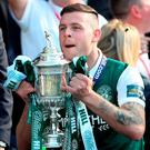 Anthony Stokes of Hibernian lifts the silverware following the Scottish Cup Final against Rangers at Hampden Park. Photo: Ian MacNicol/Getty