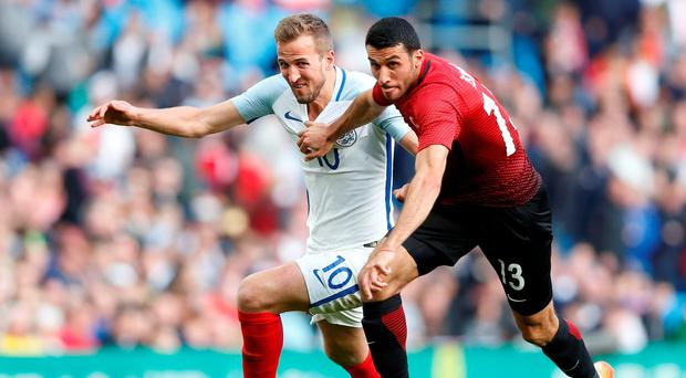 England's Harry Kane in action against Turkey's Ismail Koybasi. Photo: Reuters/Carl Recine/Reuters