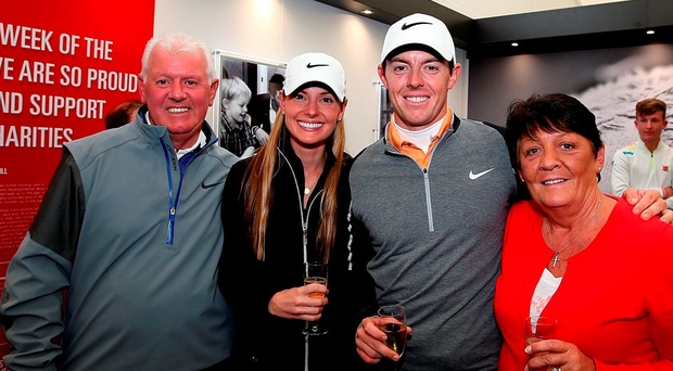 Rory McIlroy celebrates with his father Gerry, mother Rosie and fiancée Erica Stoll after victory in the final round at the K Club Photo: Jan Kruger/Getty Images