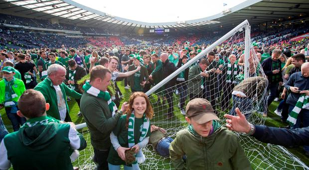 Hibernian fans invade the pitch after the William Hill Scottish Cup Final, at Hampden Park. Photo: Jeff Holmes/PA
