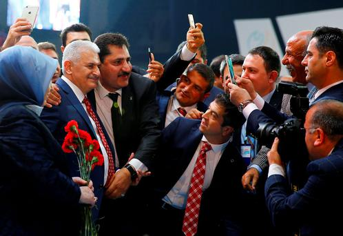 Turkey's Transport Minister Binali Yildirim (second from left) poses with members of his AKP party at a congress in Ankara. Photo: Reuters
