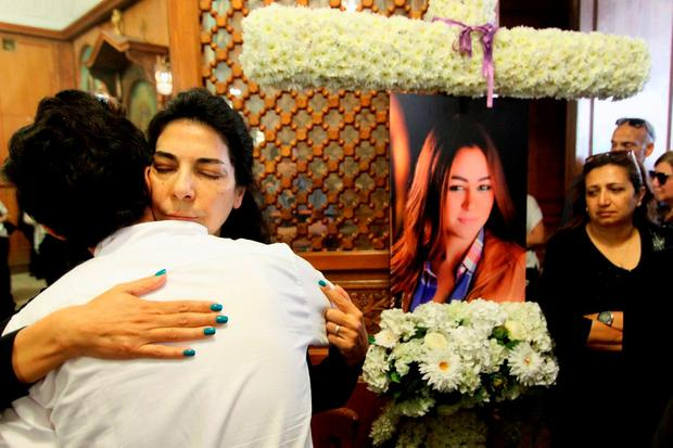 Relatives and friends of EgyptAir hostess Yara Hani (portrait), who was on board Flight 804 mourn during prayers at a church in Cairo. Photo: Getty
