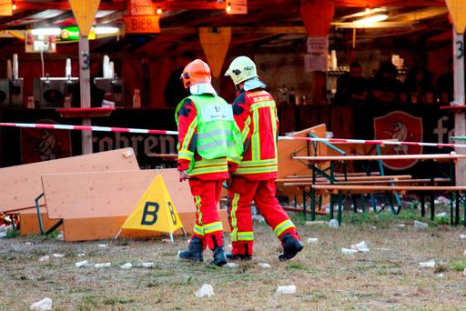 Firemen at the crime scene in Nenzing, Austria, where a man shot two people and wounded several others with a gun before turning the weapon on himself during a concert yesterday. Photo: AFP/Getty