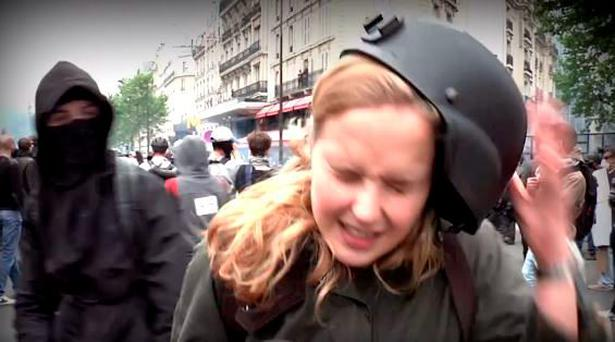 Anna Baranova was reporting for Russia Today when she was smacked across the head by a man wearing a mask